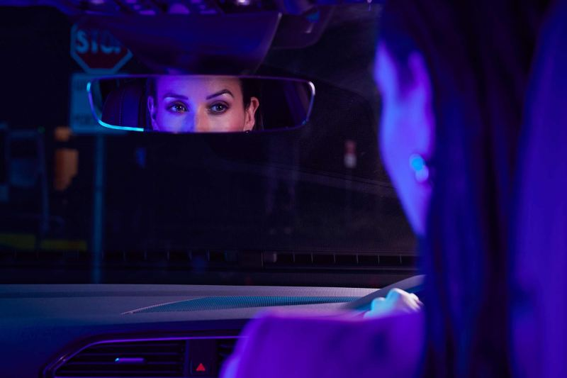 Close up of womans eyes in rearview mirror of Volkswagen Tiguan.