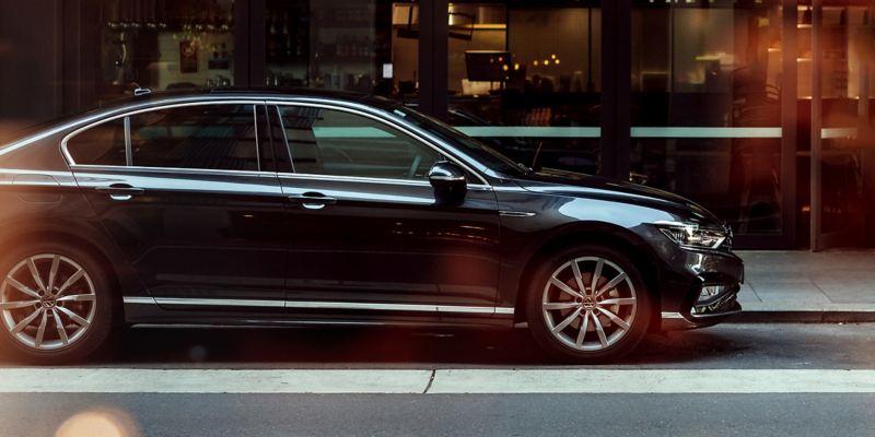 Side profile of parked grey Volkswagen Passat