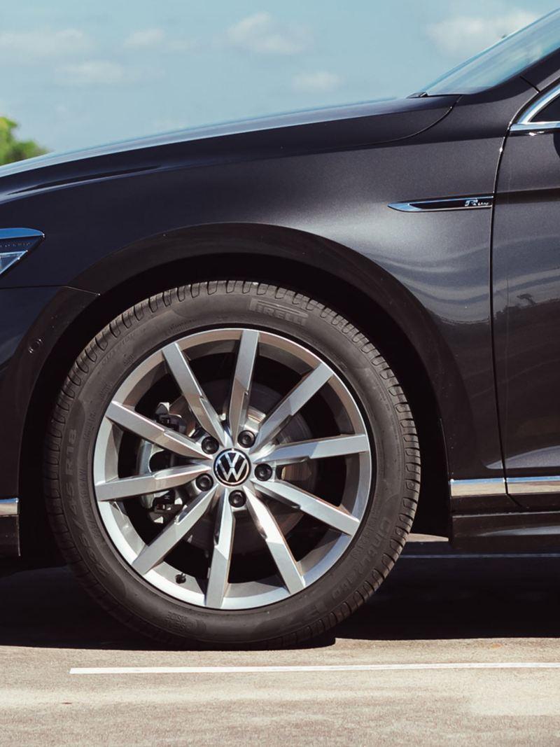 Side profile close up of parked grey Volkswagen Passat
