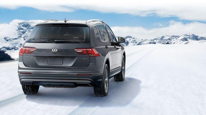 A Tiguan on a snowy road