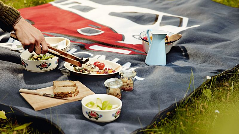 An outdoor picnic on the VW Commercial Vehicle picnic blanket