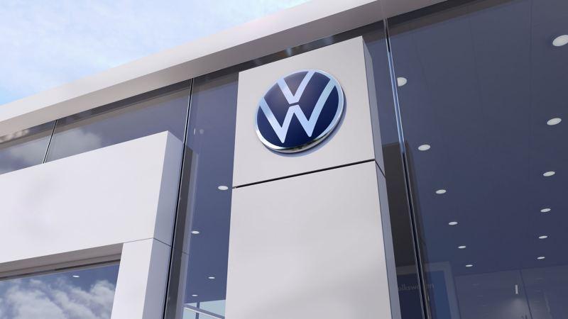 The Volkswagen logo at a Volkswagen dealership