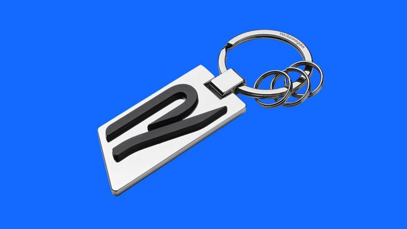 Portachiavi rettangolare in acciaio originale Volkswagen con la lettera R stilizzata.