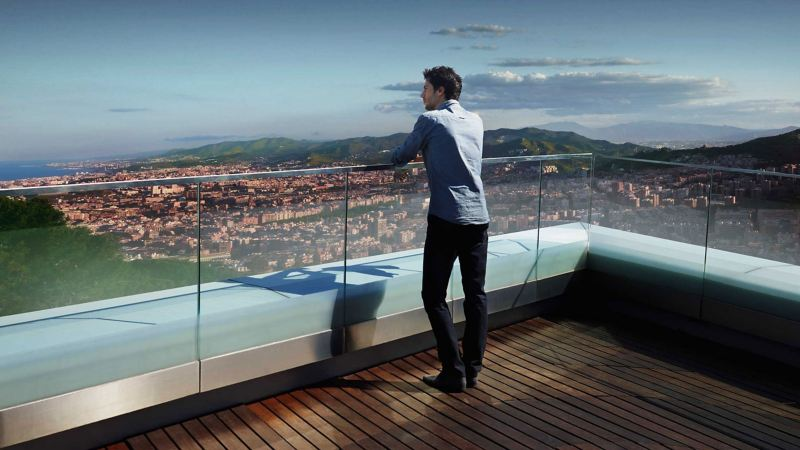 A man on a roof top enjoys the view of a city – WLTP test procedure