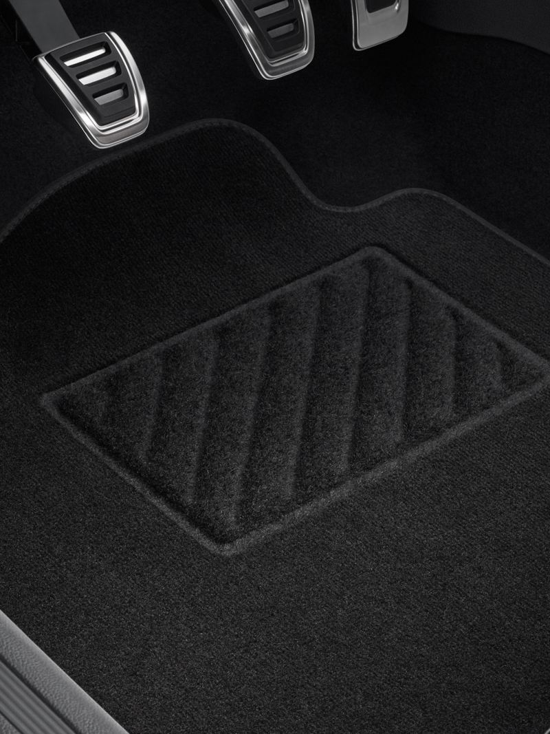 VW Accessories fabric floor mats in the footwell of an orange car