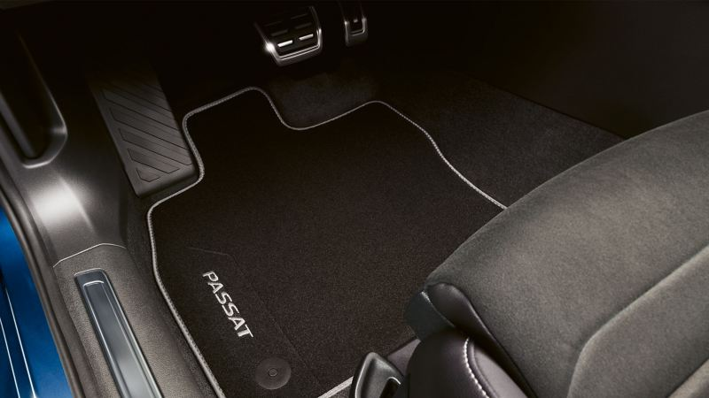 VW Accessories floor mats in the footwell of a blue VW Passat
