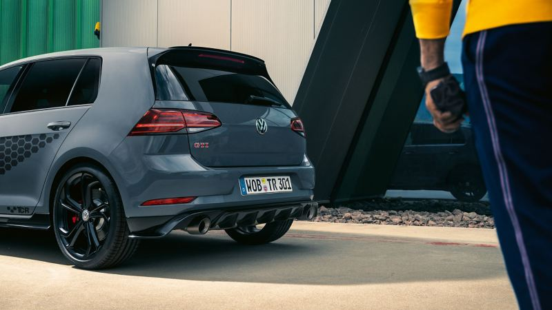 A grey VW Golf GTI with stylish accents and a tuned lowered suspension