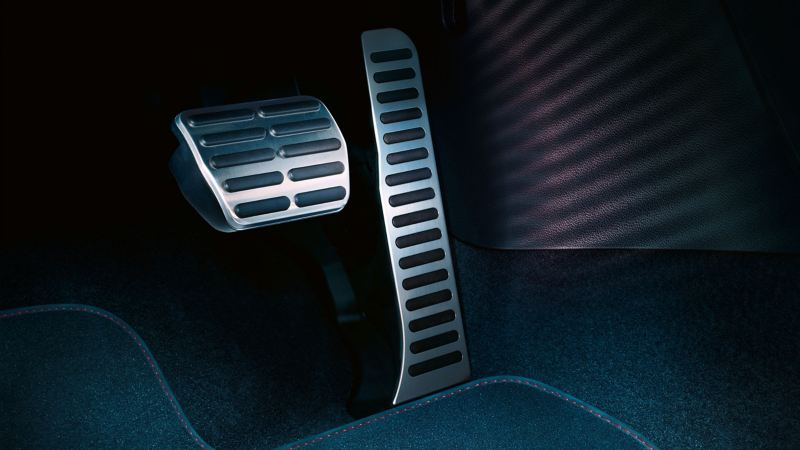 Detailed view of the footwell of a car with a stylish pedal pad set – Volkswagen Accessories