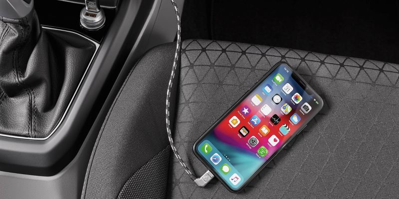A smartphone is connected with a Volkswagen via USB premium cable
