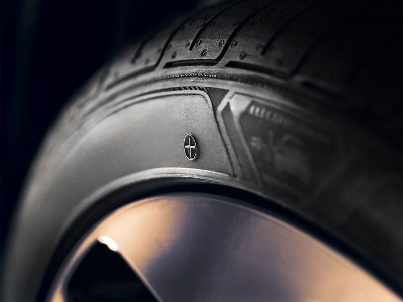 A detailed view of the side of a Volkswagen Genuine +Tyre