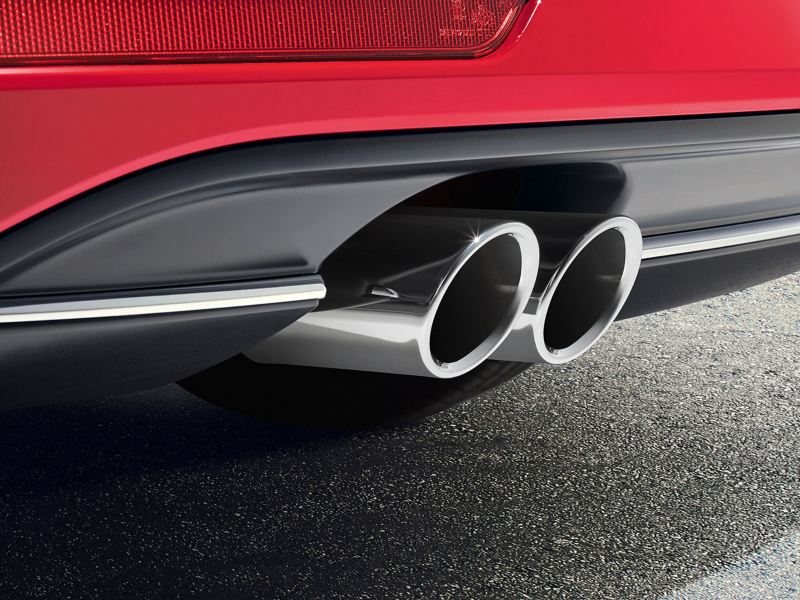 A red VW car with tuned rear silencer muffler – Volkswagen Accessories