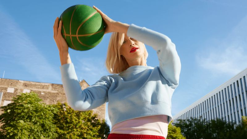 A female student holding a basketball