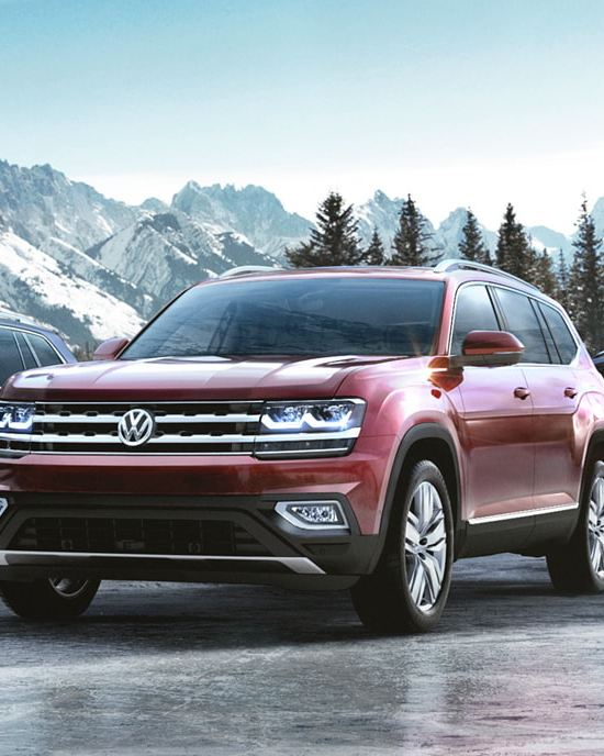 """A red Volkswagen Atlas SUV, link out to VW """"4MOTION"""" Page"""