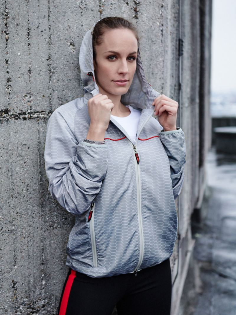 A woman wears a jacket from the VW GTI Collection