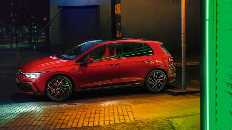 VW Golf GTI in red, side view, luminous IQ.Light headlights, luminous exterior ambient lighting