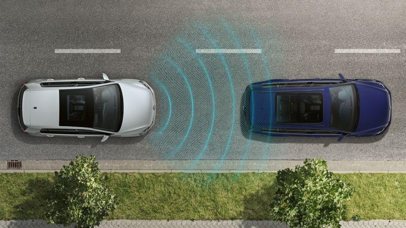 Dwa Volkswageny nocą widziane z góry. Sensoryka funkcji awaryjnego hamowania w mieście przedstawiona za pomocą linii