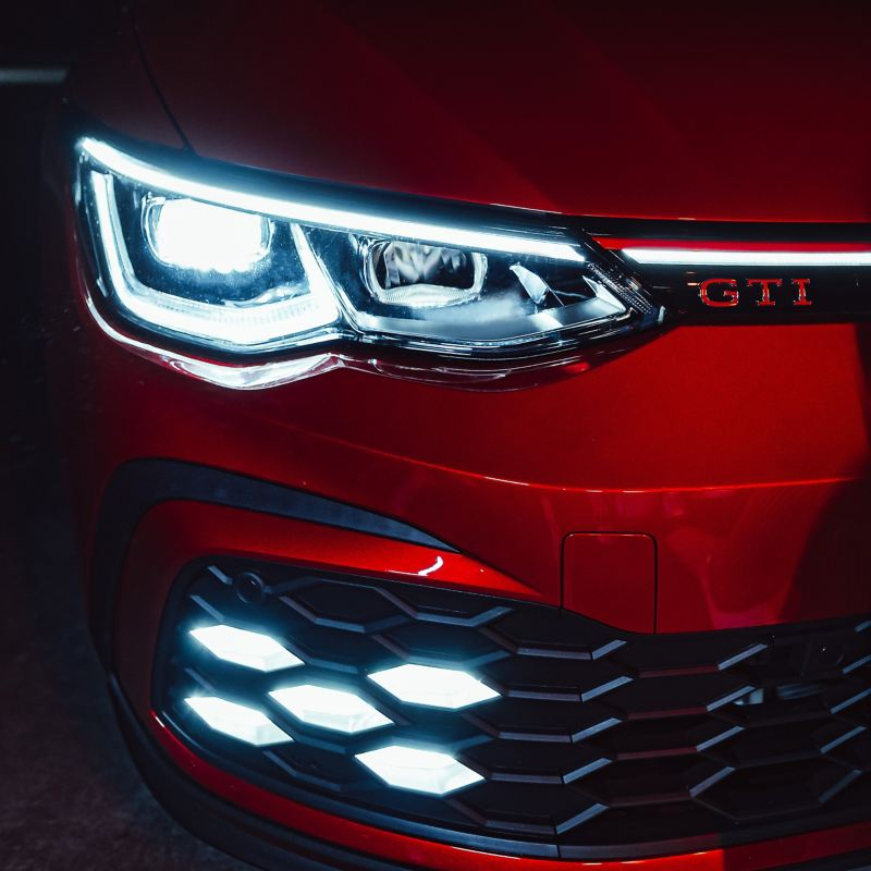 Close up on Volkswagen Golf GTI front grille and headlights.