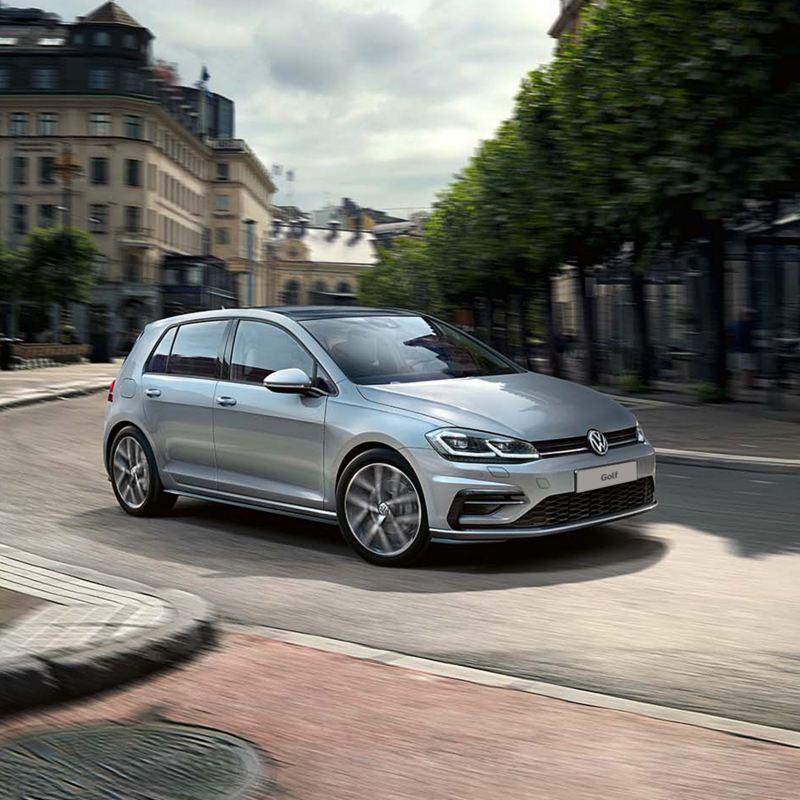 The Volkswagen Golf in silver driving around a corner