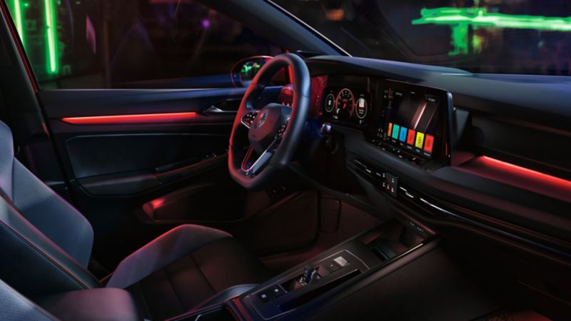 Interior of the Golf GTI cabin with the signature red line illuminated
