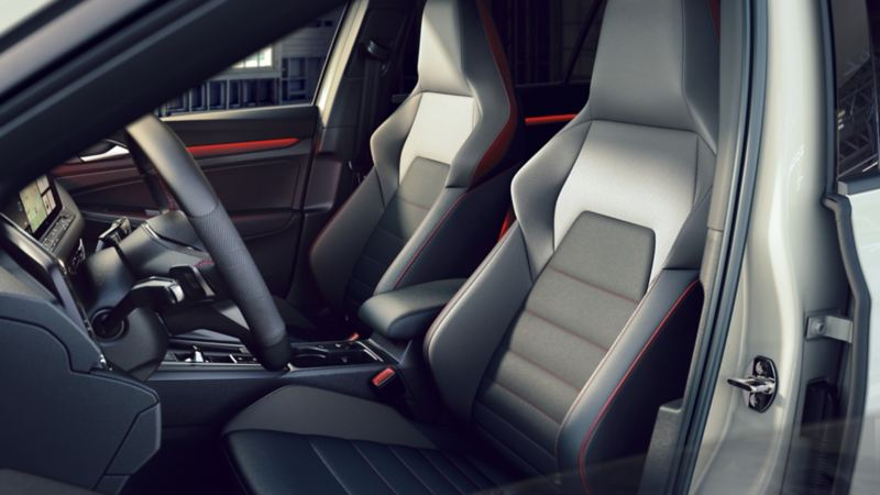 Interior of the Golf GTI cabin, showing the racing-style front bucket seats