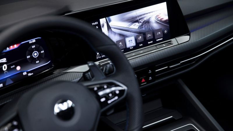The interior of a Golf R showing the multi-function steering wheel and Volkswagen Digital Cockpit.