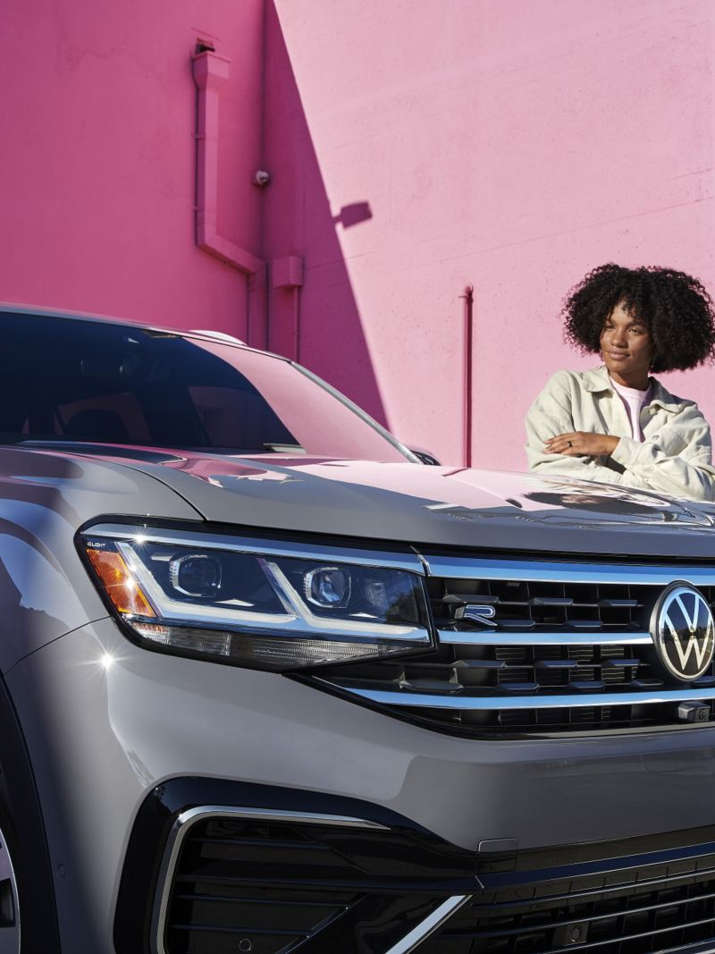 A woman standing in front of the Atlas Cross Sport, outgoing link to newvehicles.vwmodels.ca