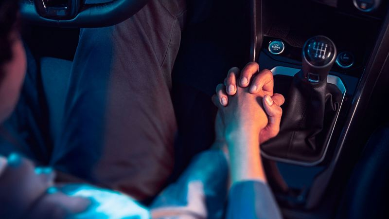 Man and woman holding hands in their VW vehicle – Volkswagen battery