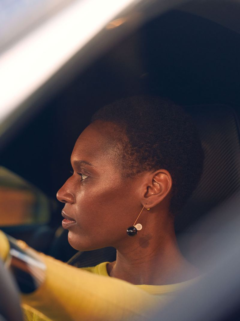 A woman sits at the steering wheel of her Volkswagen Arteon R