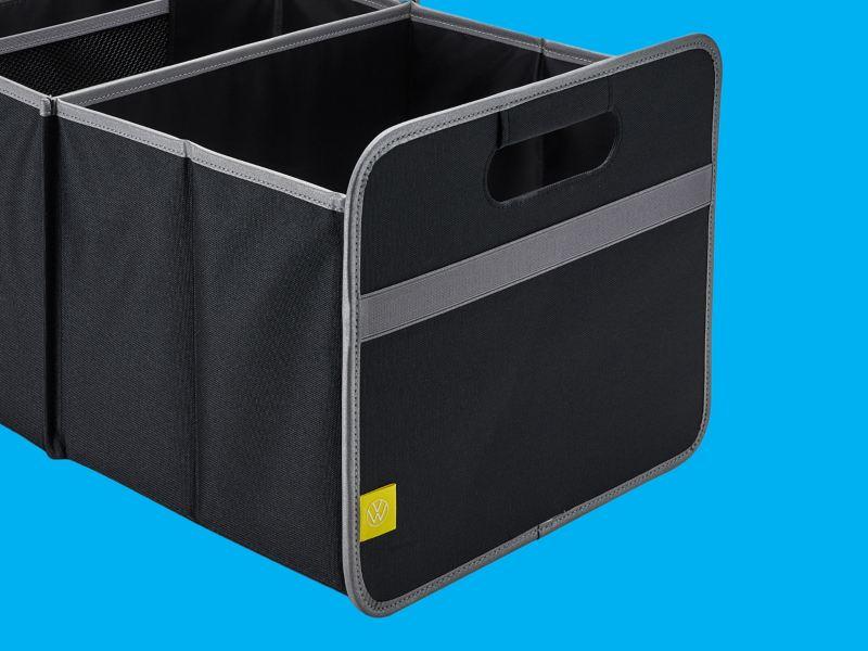 Une boîte pliante noire et grise avec le logo VW jaune – Accessoires Volkswagen