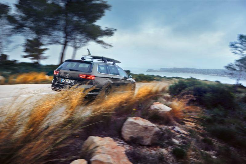 Rear quarter of Volkswagen Passat Alltrack on dirt road.