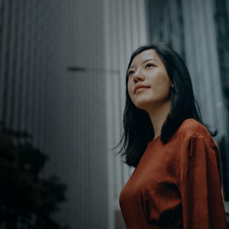 Woman smiling in an urban area