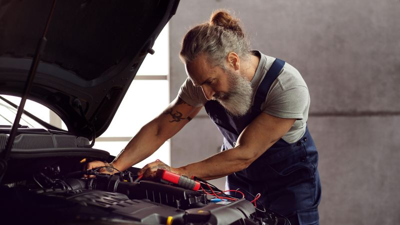 VW employee carrying out a timing belt replacement