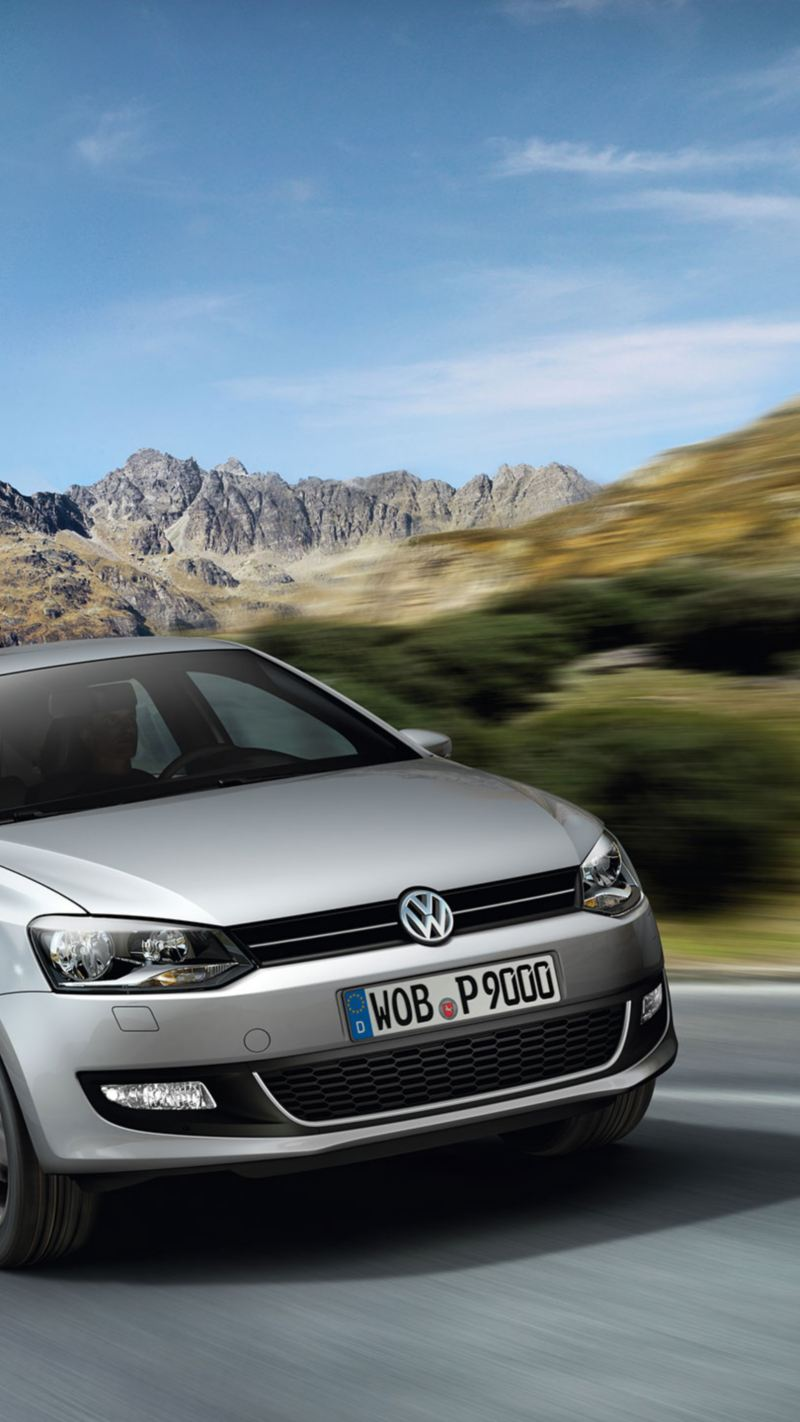 An older Polo on the road in nature – Volkswagen older models