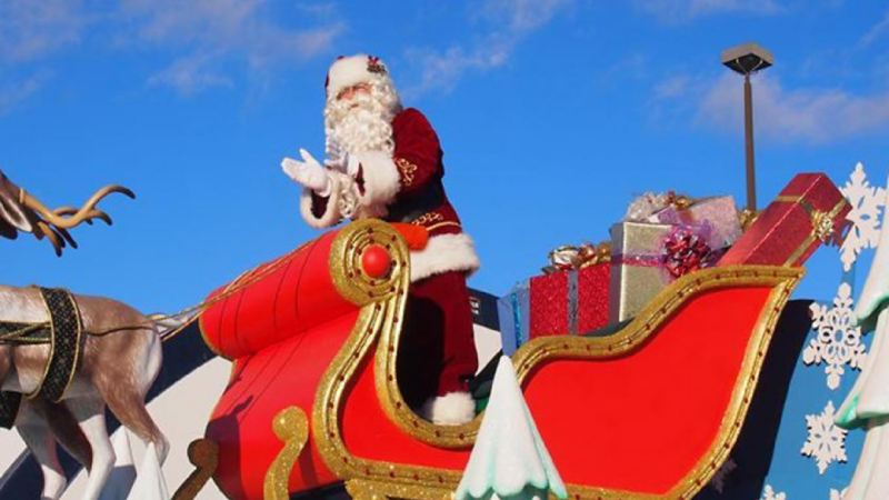 Santa Clause in his sleigh at day.