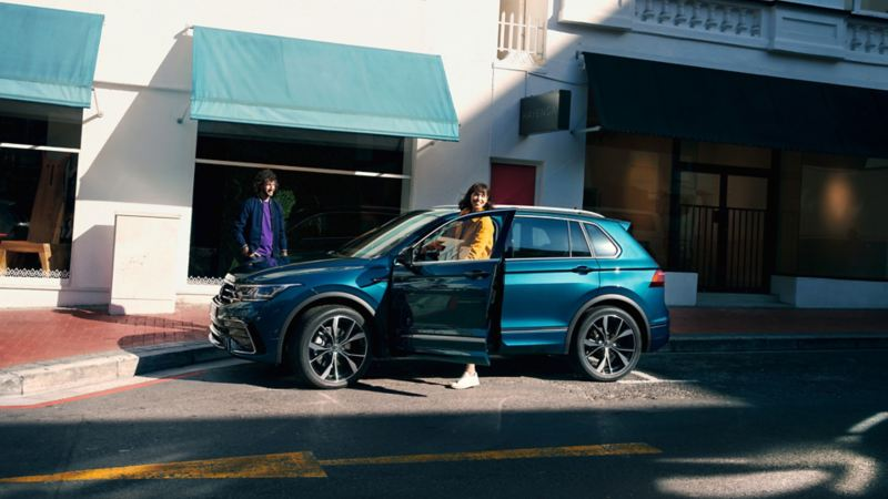 Woman gets out of VW Tiguan on driver's side