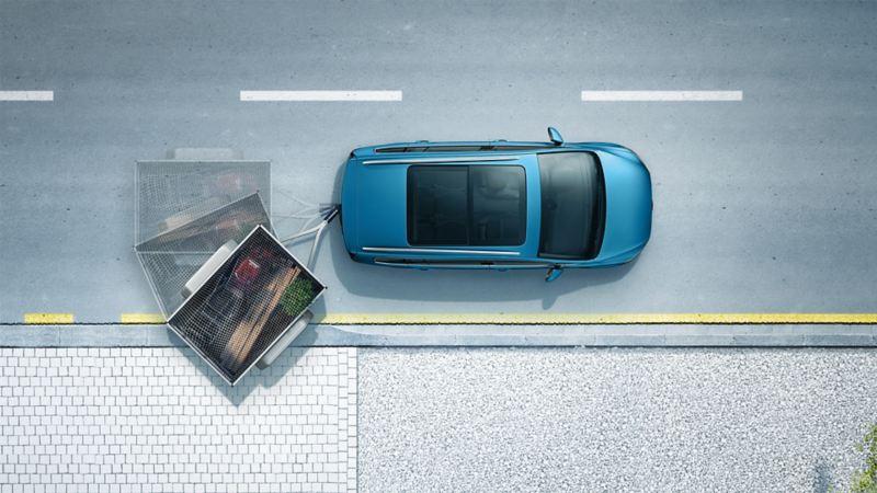 Schematyczne przedstawienie asystenta manewrowania z przyczepą Trailer Assist w VW Tourananie