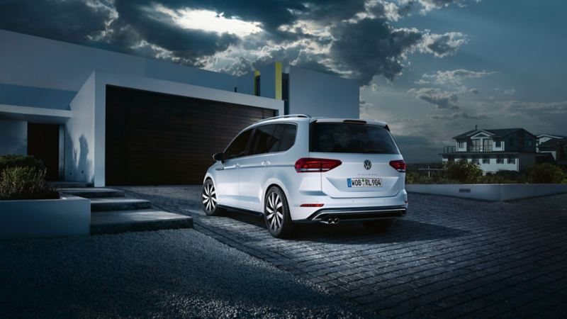"""VW Touran rear view with R-Line """"Exterior"""" equipment on garage drive"""