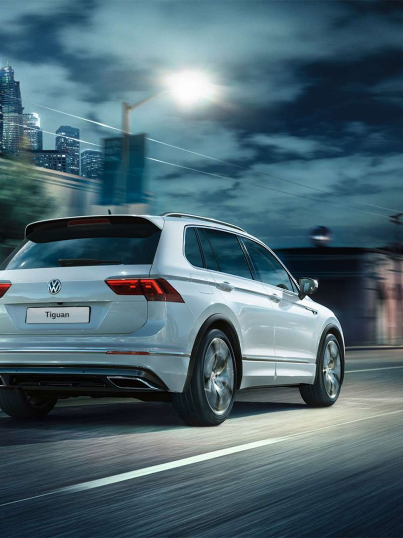 Rear-view of the Volkswagen Tiguan R-Line driving down a road