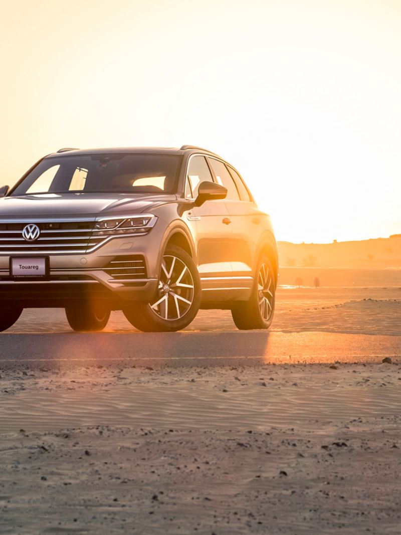 The Volkswagen Touareg parked on a desert road in Dubai, Middle East