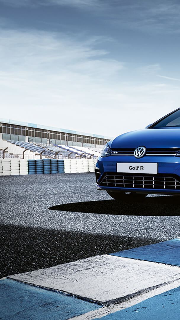 Volkswagen Golf R MK7 painted in Lapis Blue Metallic parked on a racetrack