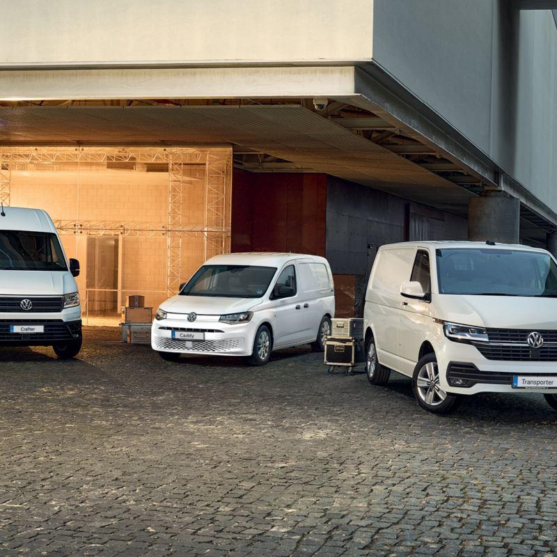 Volkswagen Transporter, Volkswagen Caddy, and Volkswagen Crafter outside building