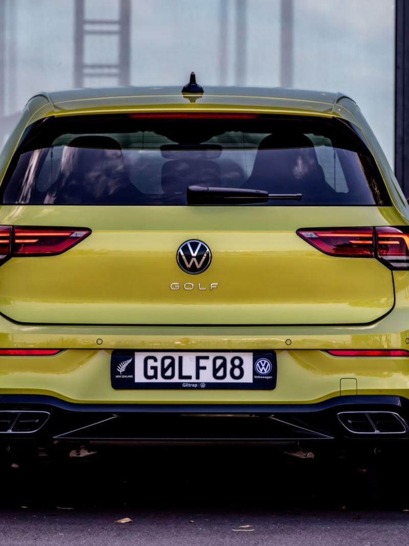 Woman sits on VW Golf bonnet