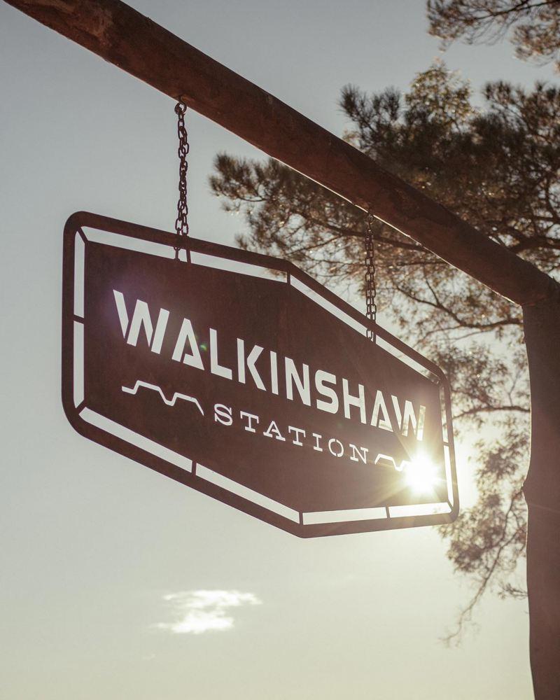 Walkinshaw Station sign hanging from gate to paddock
