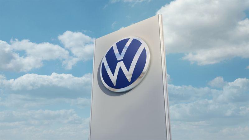 Volkswagen Service Pylon vor blauem Himmel