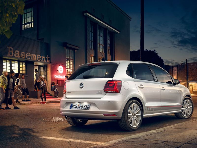 """A silver VW Polo 5 """"beats"""" with grey and red design accents is parked on a road next to a club – Volkswagen older models"""