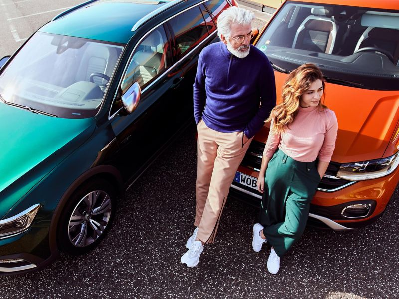 Father and daughter next to their cars with VW accessories