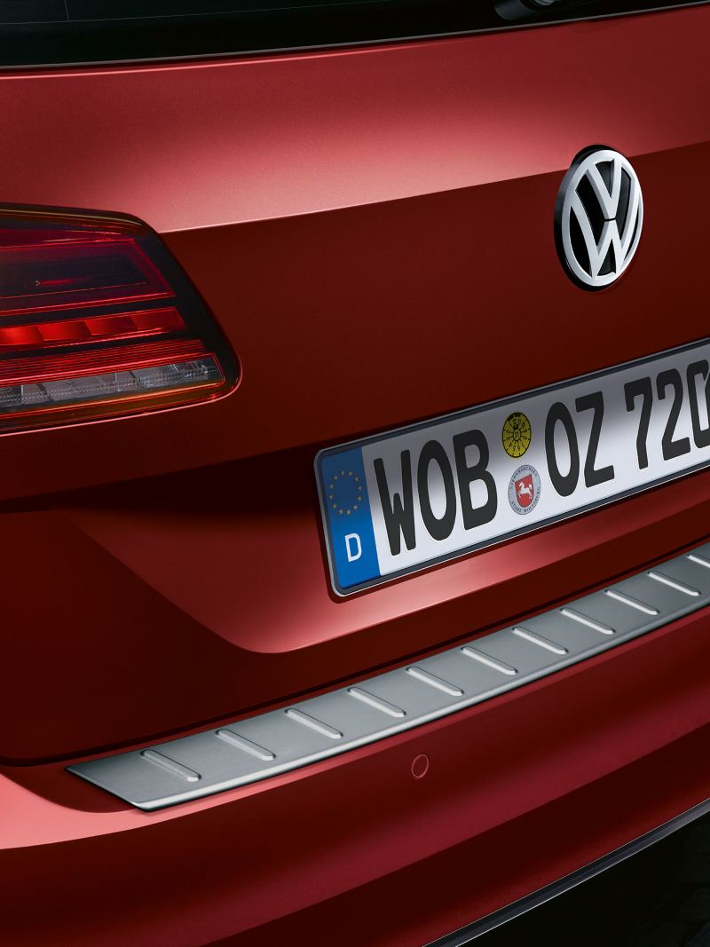 A red VW car with Volkswagen Accessories Load sill guard to protect the car
