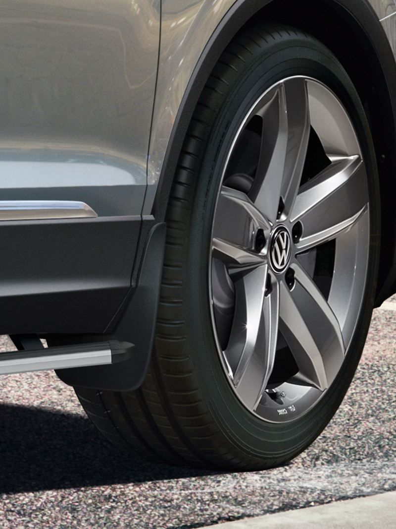 A silver Volkswagen with mudguards from VW Accessories