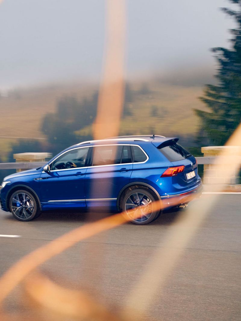 The Tiguan R from Volkswagen R drives along a road
