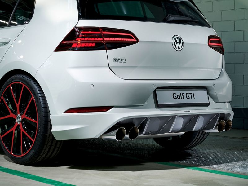 A white Golf GTI with an aerodynamic rear apron – Volkswagen sport and design products for tuning